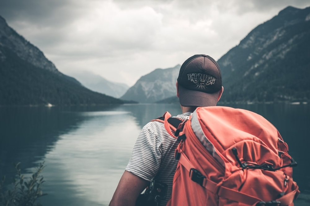 guy with orange backpack for travel