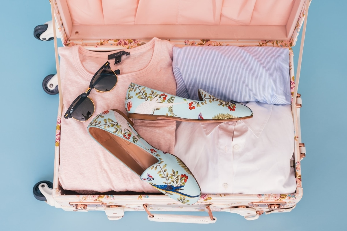 pink suitcase packed for travel